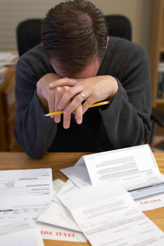 man-frustrated-because-of-too-much-debt